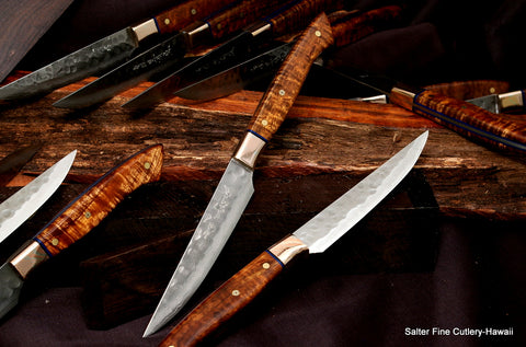 Custom steak knife set with hammered blades and mokume metal bolsters