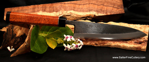 Shirogami carbon steel chef knife with black matte finish with handle of kiawe, ebony, and buffalo horn with nickel-silver accent