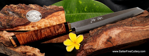 Kiritsuke slicing knife with 'combat chef' style handle featuring rare super curly koa wood and brass accents