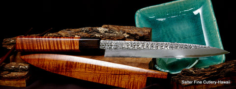 Hand-forged Aogami steel with a rustic looking hammered finish and simple faceted design handle