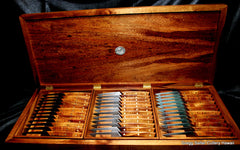 "36-piece custom steak knife set with 4.25"" blades and solid koa wood handles in presentation box."