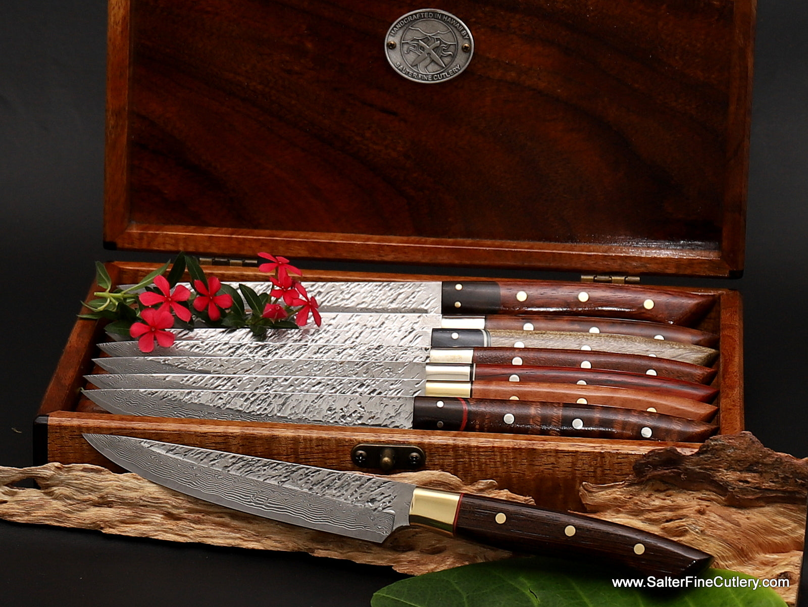 Custom handmade variety pack steak knife set including handles of black wenge wood with a brass bolster and double red accents shown in foreground from Salter Fine Cutlery