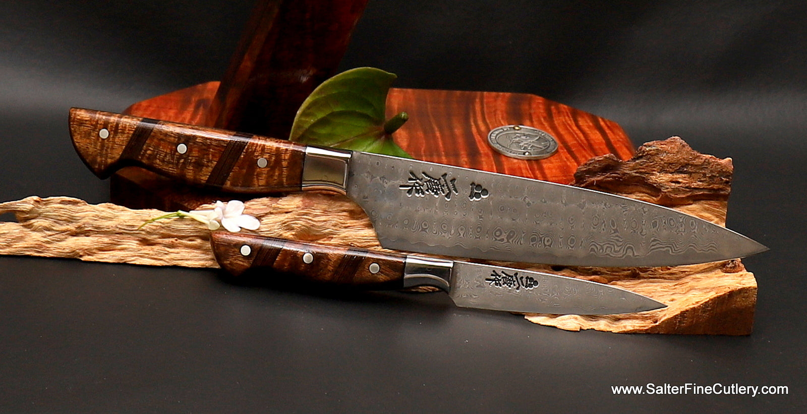 Custom order chef knives with top-of-the-line whirlpool damascus pattern and exotic koa wood handles by Salter Fine Cutlery