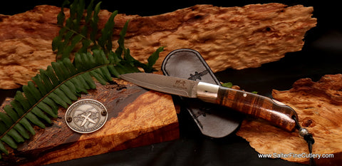 Handmade lockback folding knife with Japanese handforged stainless steel blade and curly koa wood handle from Salter Fine Cutlery