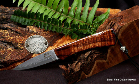 "Folding lockback pocket knife with 3"" hand-forged blade, curly koa wood handle without bolster, and titanium liners"