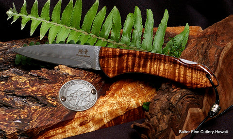 3.5 inch folding pocket knife featuring titanium liners, hand-forged Japanese VG10 damascus blade and beautiful curly koa wood handle