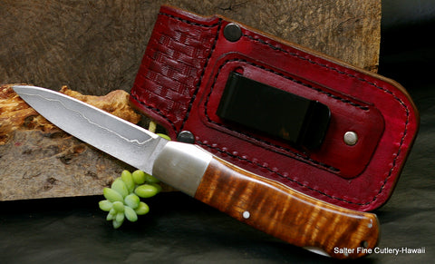 "3.5"" folding pocket knife showing reverse side and metal belt clip of handmade leather sheath"