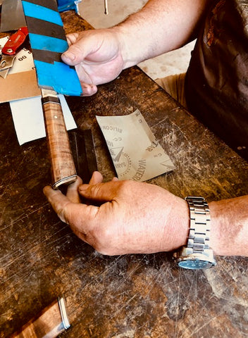 Inspecting the handle during final phases of handle creation for a new 2-piece chef knife set from Salter Fine Cutlery creators of handmade luxury cutlery