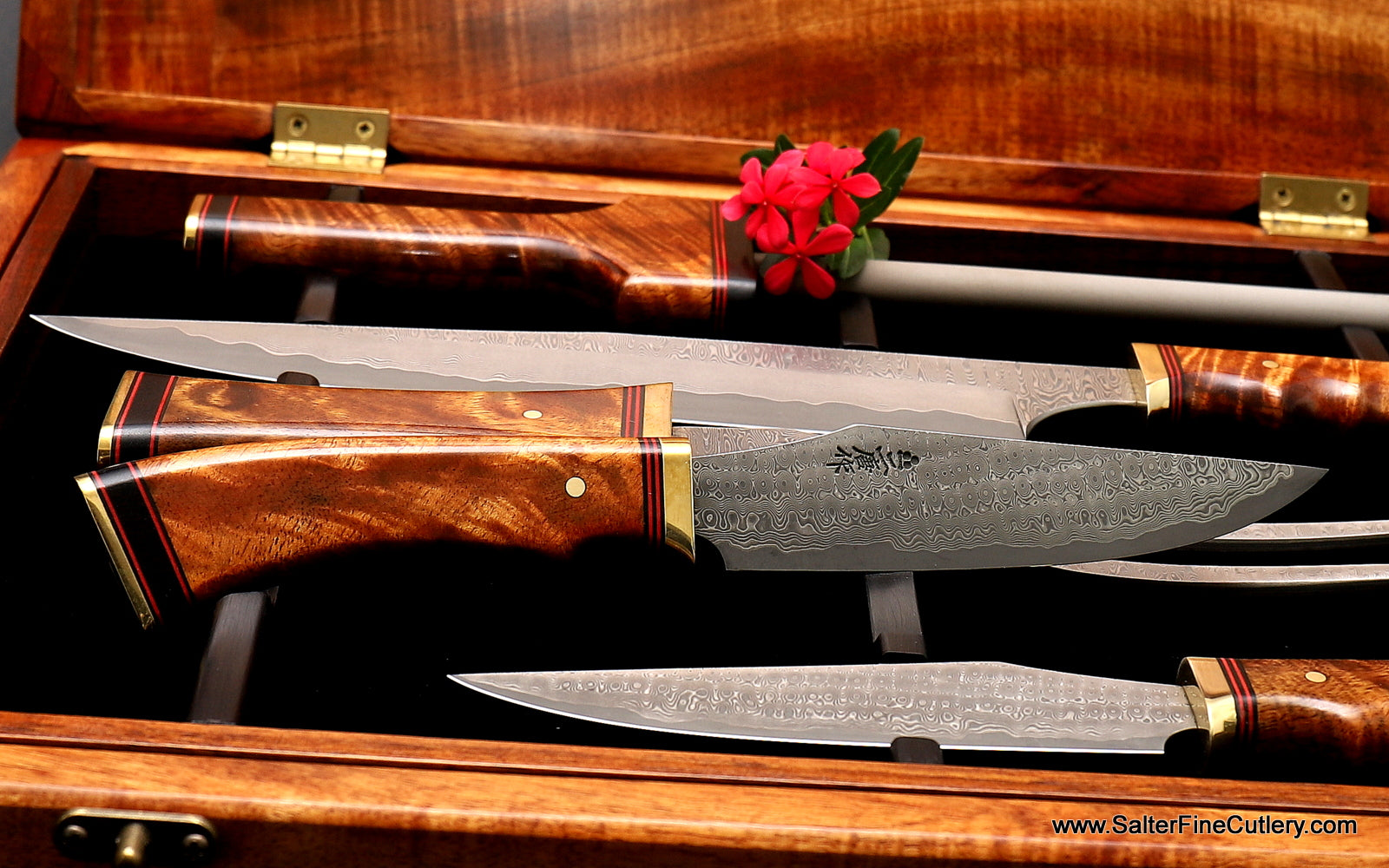 138mm clip point Charybdis design luxury steak knife with brass, red and black accents by Salter Fine Cutlery