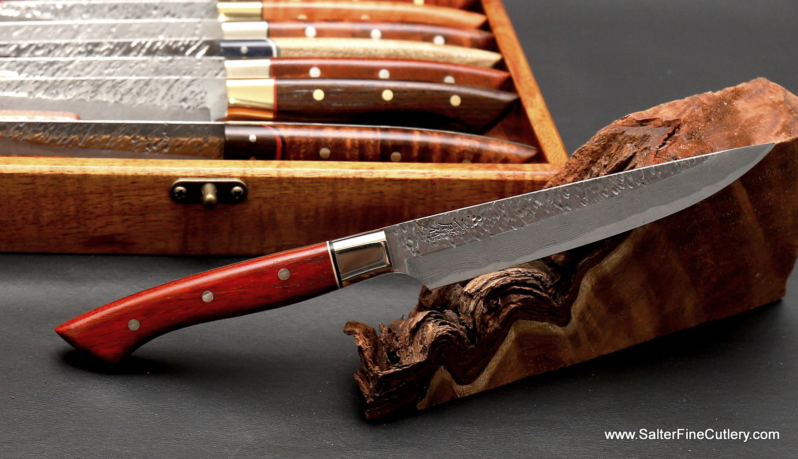 Raptor design luxury handmade tableware including choice of exotic wood handles like this cocobolo wood with nickel-silver contoured bolster and black and white accents from Salter Fine Cutlery