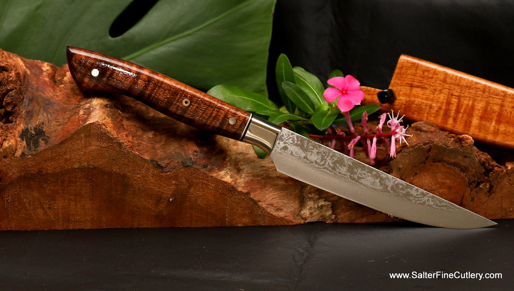 Single handcrafted steak knife with damascus stainless steel blade and koa wood handle from Salter Fine Cutlery of Hawaii
