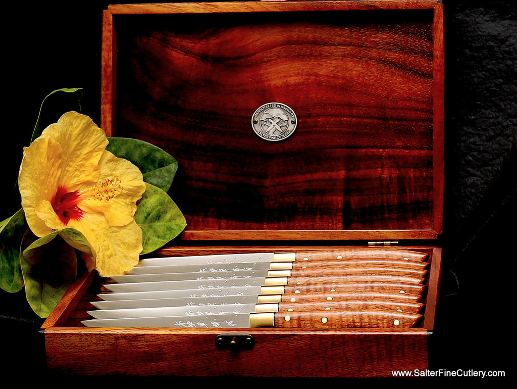 8-piece steak knife set handmade with exotic curly koa wood and R2 stainless steel and individually hand-forged blades with brass bolsters from Salter Fine Cutlery of Hawaii