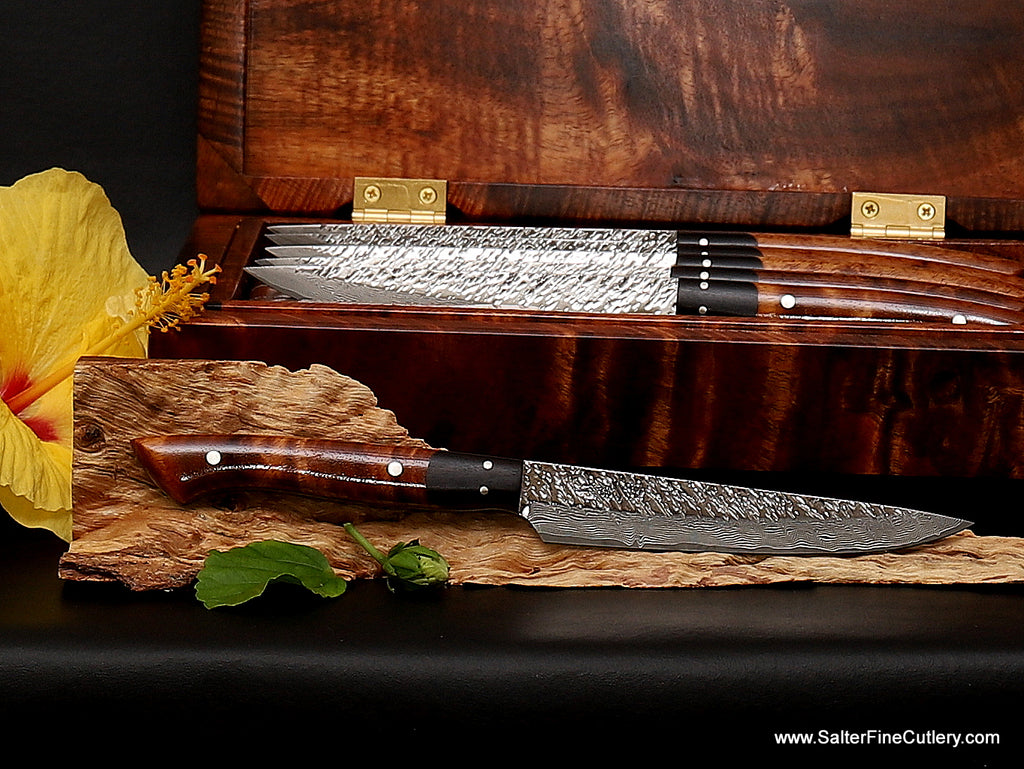 Raptor steak knife set showing blade detail with set in background luxury dinnerware from Salter Fine Cutlery of Hawaii