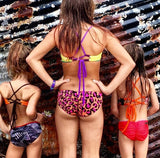 Matching rear view of Our Savage MINI Bikinis for your lil' girls! These are the kids version (full coverage) of our most popular AMY bikini bottom. All are reversible and fully custom...and as always, proudly made right here in the USA! (St. Augustine Fl)