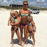 Matching Momma view of Our Savage MINI Bikinis for your lil' girls! These are the kids version (full coverage) of our most popular AMY bikini bottom. All are reversible and fully custom...and as always, proudly made right here in the USA! (St. Augustine Fl)