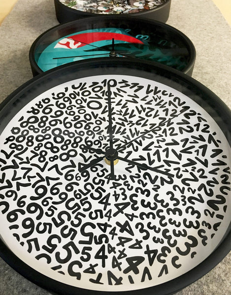 Time Flies When You're Doodling! New Wall Clocks with Doodlers Anonymous.