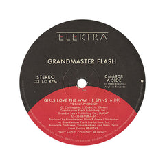 "<!--019850101012164-->Grandmaster Flash - 'Girls Love The Way He Spins/ Larry's Dance Theme' [(Black) 12"" Vinyl Single]"