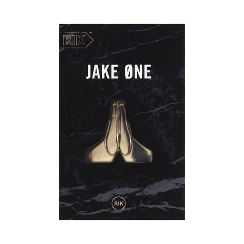 "[""Jake One - 'Prayer Hands' [(Black) Cassette Tape]""]"