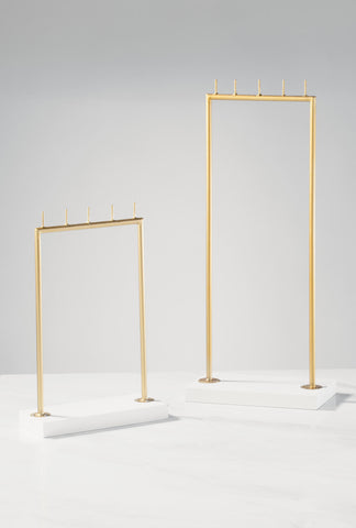 Gold posts and white base jewelry holder