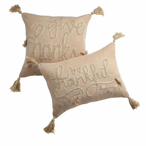 Beige pillow with tufted sentiment
