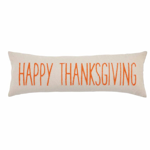 "Cream pillow with ""HAPPY THANKSGIVING"" in orange"