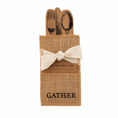 "Brown jute pouch with the word ""Gather"" printed on the front and a ribbon."
