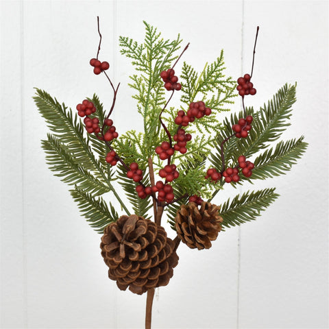 Spray with spruce, cedar, red berries and pine cones