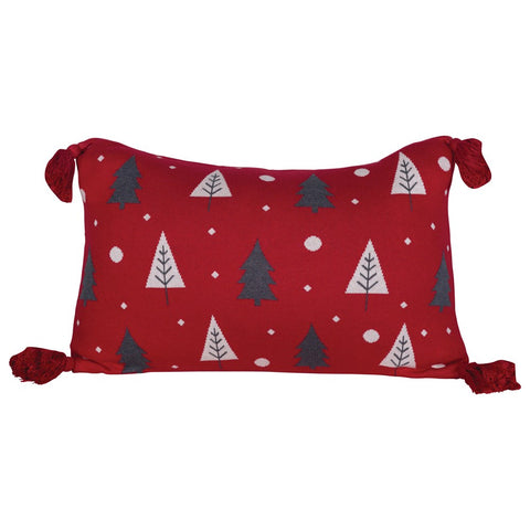 Red pillow with gray & white Christmas trees and red tassels on the corners