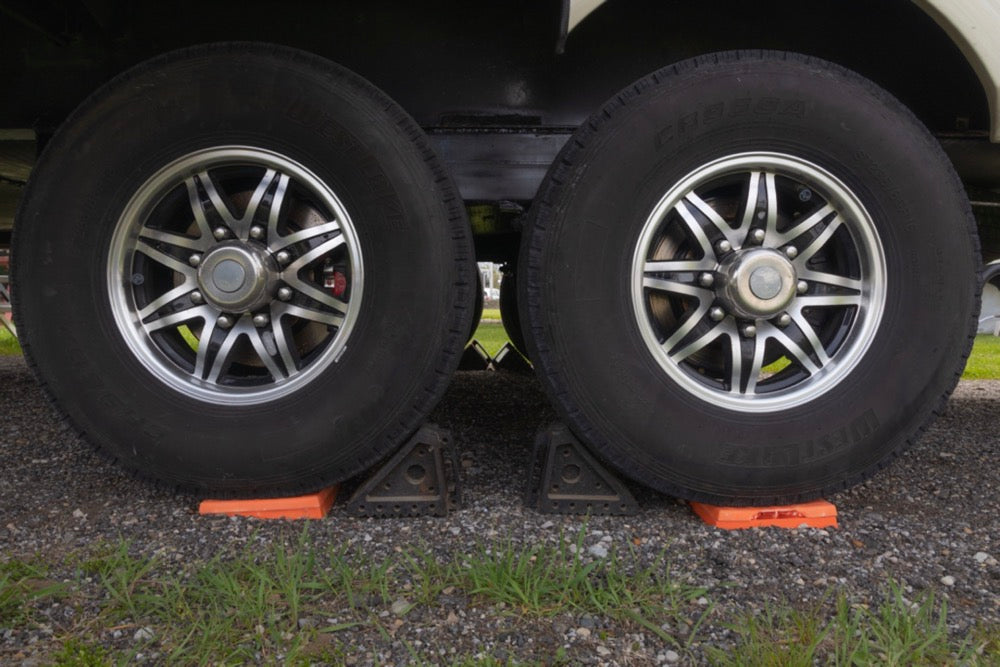Wheel chocks and blocks on fifth wheel while leveling.
