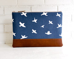 white birds in flight across the front of 13 inch laptop cover