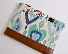Ikat laptop case in blues and cream has a cute front pocket to carry small extras including a pen earbuds and ipod