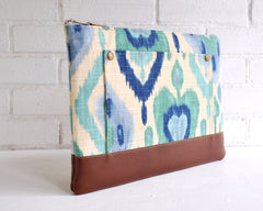Take a trip the desert southwest with this durable laptop case with an blue green and cream ikat print