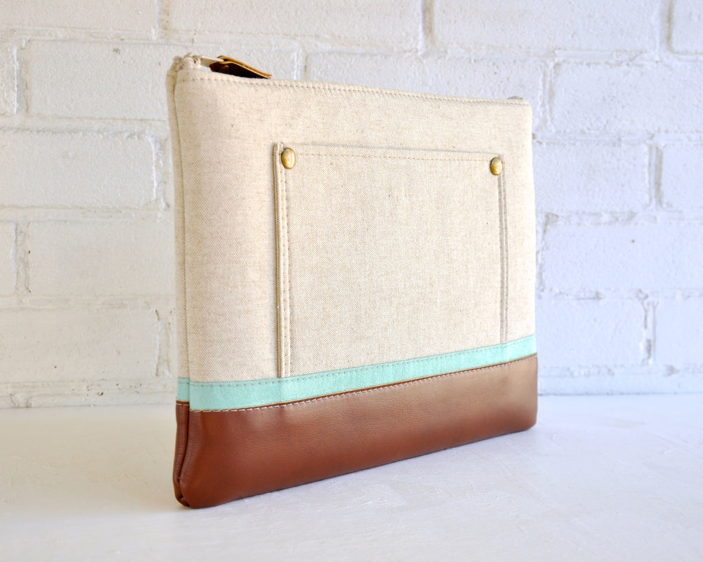 Beautiful beige and mint computer bag with recycled leather edge and brass rivets