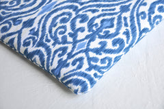 Detail view of ikat print in indigo blue and white