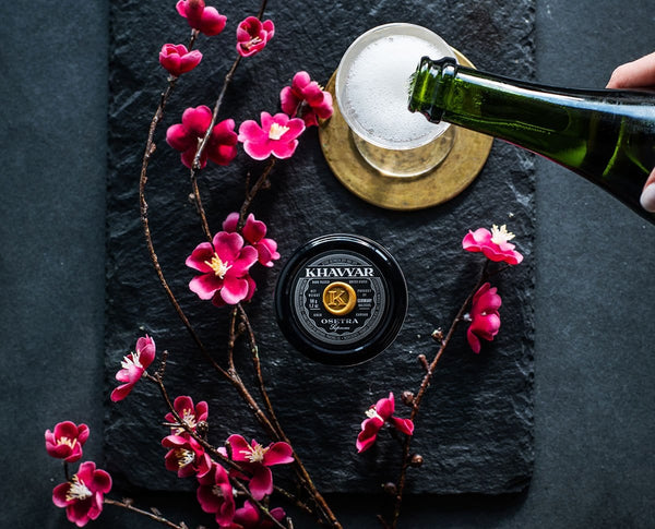 Osetra Caviar Imported From Belgium with Served with Champagne Presented on Slate with Summer Flowers