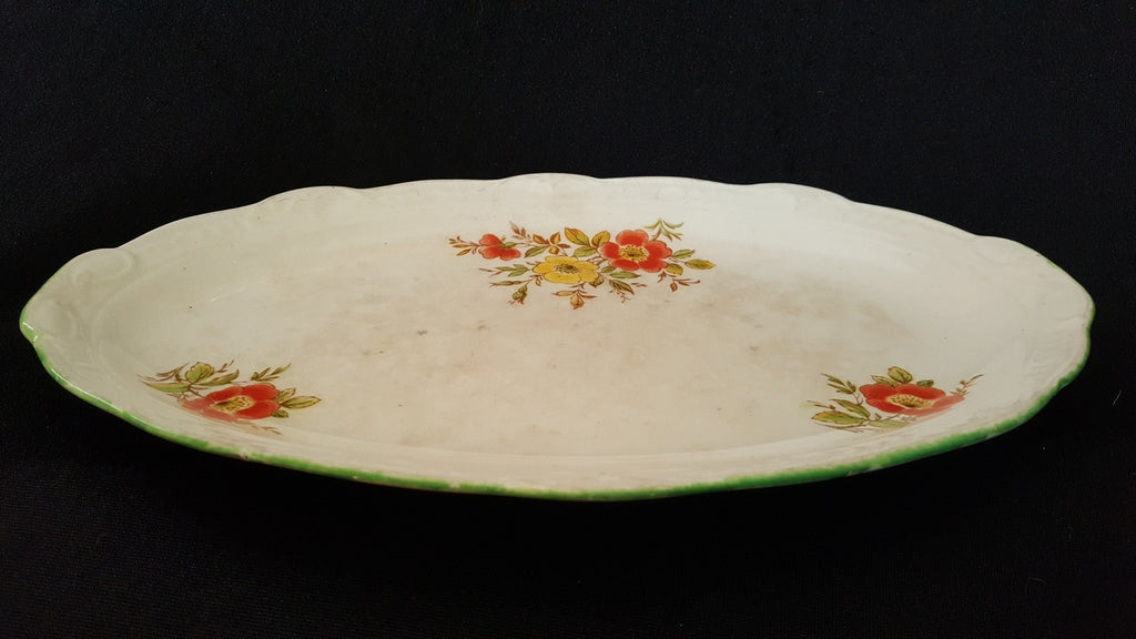 Swinnertons Staffordshire Oval White Floral Ceramic Plate, made in England.
