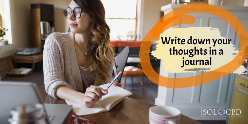 Keep calm with CBD and write down your thoughts in a journal.