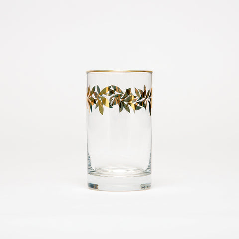 Color of abundance #7: Water glass decorated with golden flowery patterns