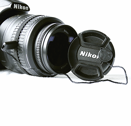 Lens Cap Strap attached to cap