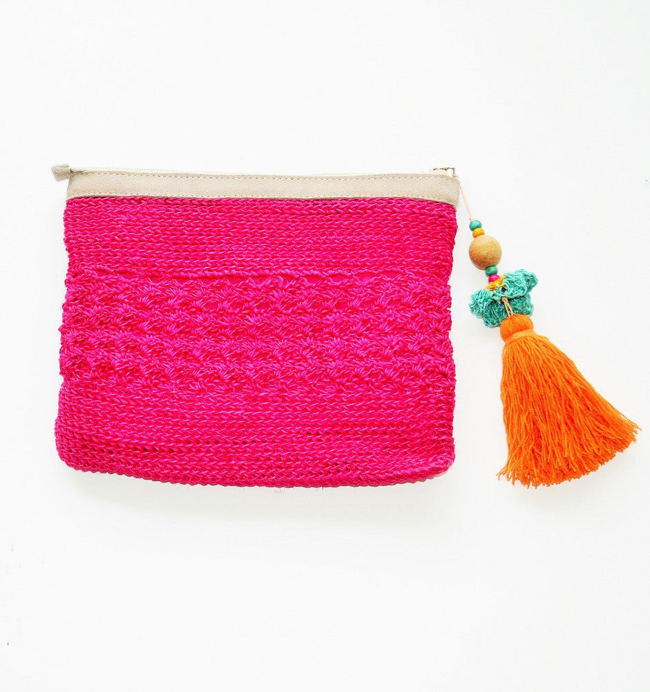 hot pink raffia boho clutch with oversized orange tassel and leather trim