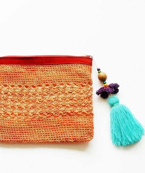 fique fiber raffia boho clutch with oversized tassel and leather trims