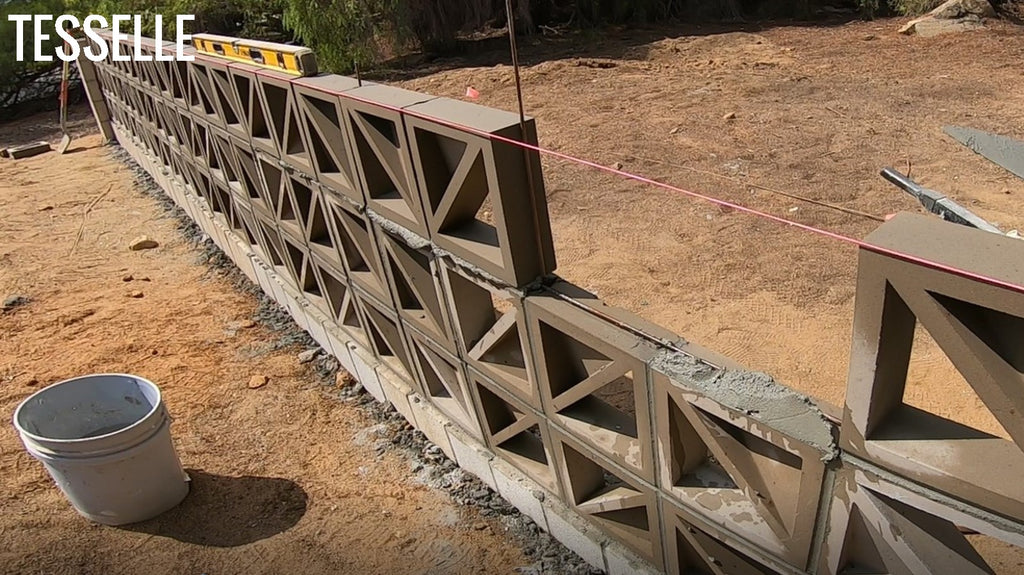Laying the 3rd horizontal course on a breeze block wall