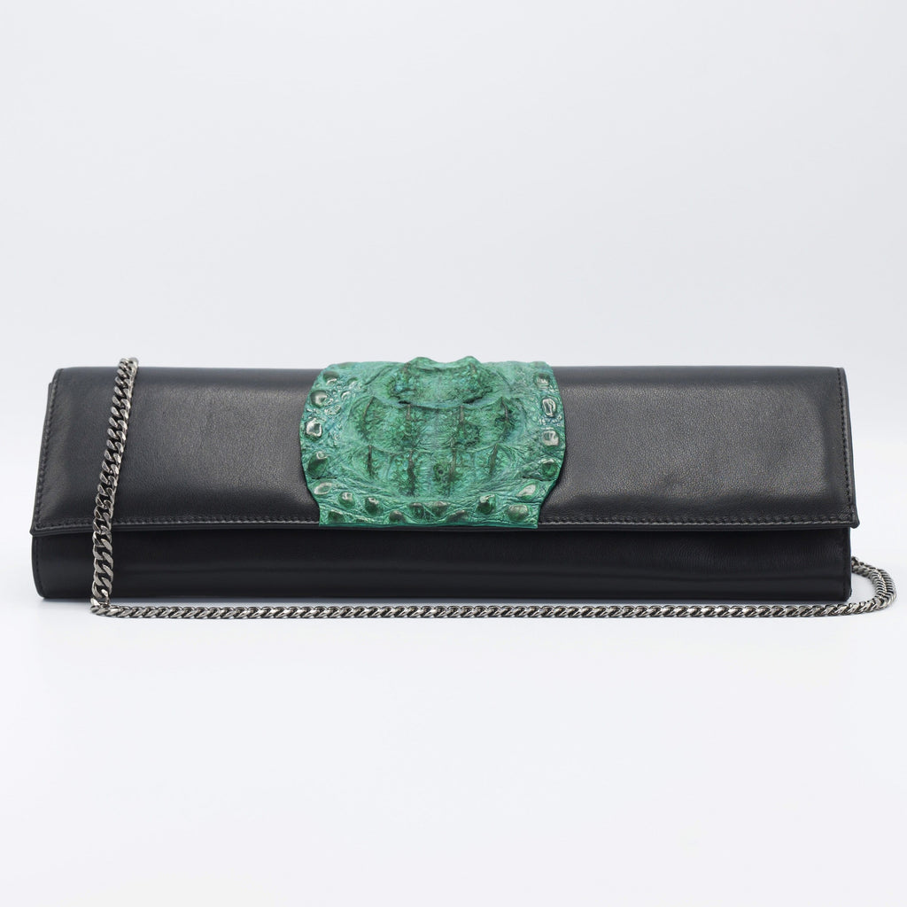 Green and Black Kate Crocodile and leather clutch. Sexy curves, sleek lines, soft materials, with bold color pallet make this an unforgettable masterpiece. Free shipping.