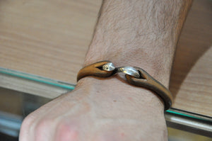 The Flat Head Silver Hook Cuff Natural Tan after 1/2 Year in use