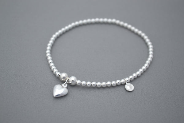 Sterling Silver bead bracelet with pretty small puff heart charm