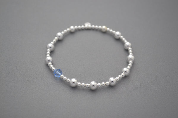 Sterling Silver small and medium ball bead bracelet with blue Swarovski crystal