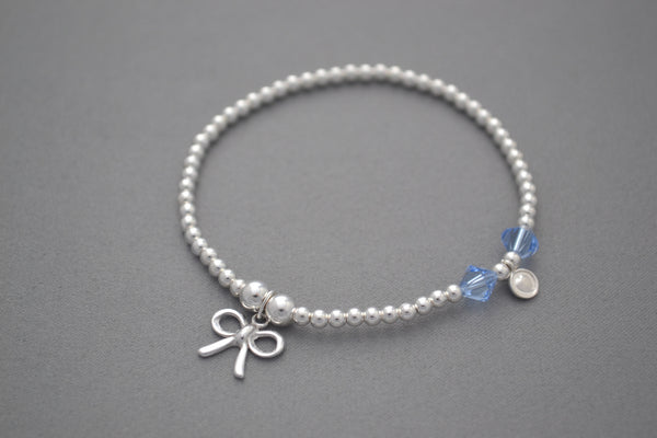 Sterling Silver small bead bracelet with blue Swarovski crystals and pretty bow charm