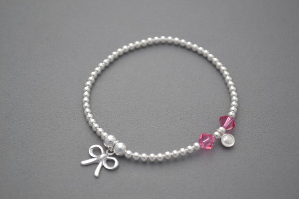 Sterling Silver small bead bracelet with pink Swarovski crystals and pretty bow charm