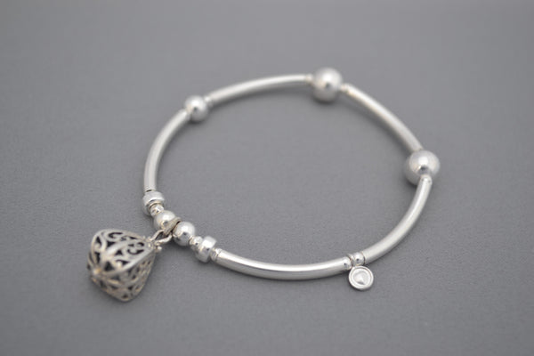 Sterling Silver noodle and round bead bracelet with elegant Bali charm