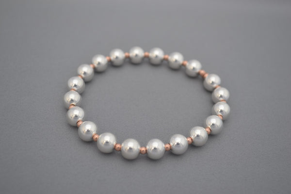 Rose Gold small ball and large Sterling Silver bead bracelet